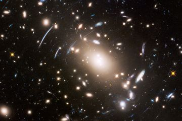 A faint glow found between galaxies could be a beacon for dark matter