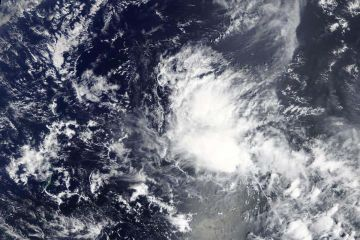 NASA sees development of Tropical Depression 03W near Yap